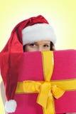 Christmas Smiling Woman. In red santa cap Royalty Free Stock Photo