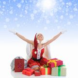 Christmas Smiling Woman. In red santa cap with a gift Royalty Free Stock Photos