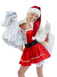 Christmas Smiling Woman. In red santa cap with a gift. isolated on a white background Stock Photography