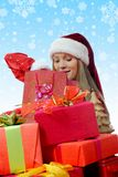 Christmas Smiling Woman. In red santa cap with a gift Stock Photography
