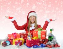 Christmas Smiling Woman. In red santa cap with a gift Royalty Free Stock Image