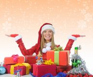 Christmas Smiling Woman. In red santa cap with a gift Royalty Free Stock Photography