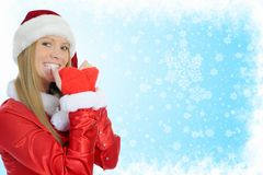 Christmas Smiling Woman. In red santa cap Royalty Free Stock Photography