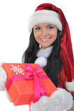 Christmas Smiling Woman. In red christmas cap with a gift. isolated on a white background Royalty Free Stock Photo