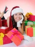 Christmas Smiling Woman. In red santa cap Royalty Free Stock Photos