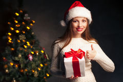 Christmas. smiling woman with gift box. Christmas, x-mas, valentine's day, celebration concept - smiling woman with gift box Stock Image