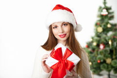 Christmas smiling woman with gift box on white. Christmas, x-mas, valentine`s day, celebration concept - smiling woman with gift box over white background and Royalty Free Stock Images