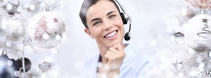 Christmas smiling woman with headset on christmas balls backgrou Royalty Free Stock Photography
