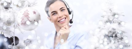Christmas smiling woman with headset on christmas balls Royalty Free Stock Photography