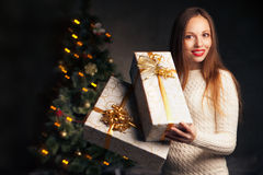 Christmas. smiling woman with many gift boxes Royalty Free Stock Photo