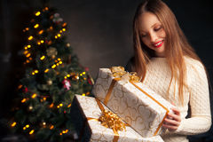 Christmas. smiling woman with many gift boxes Stock Photo