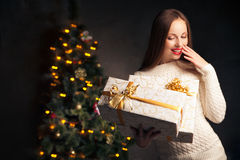 Christmas. smiling woman with many gift boxes Stock Images
