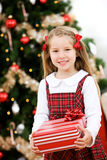 Christmas: Smiling Young Girl Holds Wrapped Gift Royalty Free Stock Photo