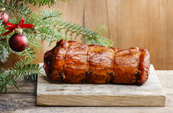 Christmas smoked ham under fir branch Royalty Free Stock Photos