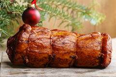 Christmas smoked ham under fir branch Stock Photo