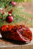 Christmas smoked ham under fir branch Stock Image