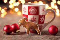 Christmas snack. Gingerbread cookie and Christmas decorations on a table stock images