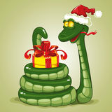 Christmas snake. Cute snake (symbol of 2013 year) in Santa's hat with Christmas gift. Vector illustration Royalty Free Stock Image