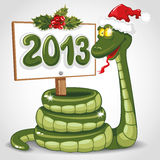 Christmas snake. Cute snake (symbol of 2013 year) in Santa's hat. Vector illustration Stock Image