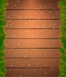 Christmas snow background with fir twigs. Wooden f Royalty Free Stock Image
