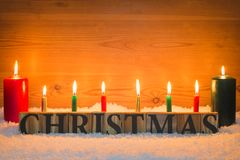 Christmas in snow with candles stock images