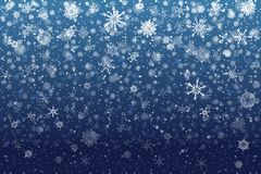 Christmas snow. Falling snowflakes on deep blue background. Snow royalty free stock images
