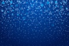Christmas snow. Falling snowflakes on deep blue background. Snow royalty free stock photography
