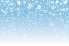 Christmas snow. Falling snowflakes on light background. Snowfall stock photos