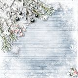 Christmas snow firtree with holly, jingle bells, snowflakes on w stock images