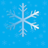 Christmas snow flakes on blue. Background Stock Image