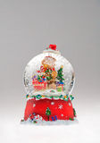 Christmas snow globe. Close up of colorful Christmas snow globe ornament. Isolated on white background Royalty Free Stock Image