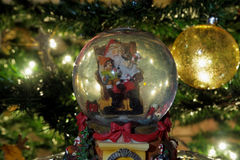 Christmas snow globe ball. Royalty Free Stock Photo