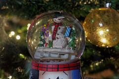 Christmas snow globe ball. Stock Photo