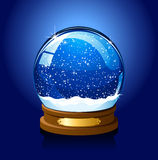 Christmas Snow globe on blue background Stock Photos