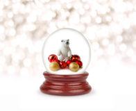 Christmas snow globe. Can be used as a Christmas or a New Year gift or symbol. Snowman with gifts royalty free stock photo