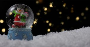 Christmas Snow Globe. With snowman on winter background stock video footage