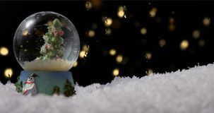Christmas Snow Globe. With tree on winter background stock footage