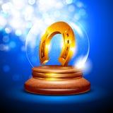 Christmas snow globe with a golden horseshoe Stock Photo