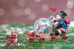 Christmas snow globe with happy snowmen stock photography