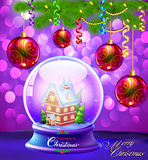 Christmas Snow globe with a house and trees Stock Photo