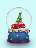 Christmas snow globe on light blue  background. Can be used as a Royalty Free Stock Photos