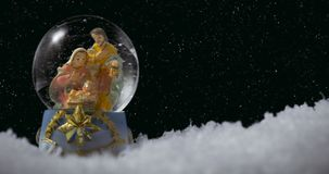 Christmas Snow Globe. With nativity on winter background stock video footage
