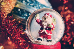 Christmas snow globe and ornaments Stock Photo