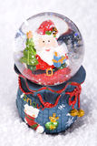 Christmas Snow globe with Santa Claus Stock Photo