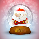 Christmas snow globe with Santa Claus Stock Images