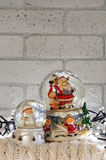 Christmas snow globe with santa claus inside and garland lights Royalty Free Stock Photography