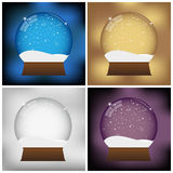 Christmas snow globe set. Set of four Christmas snow globes in different colors: blue, golden. grey and purple Royalty Free Stock Photography