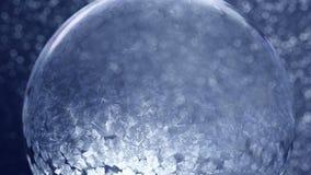 Christmas Snow Globe Snowflake on Blue Background stock video
