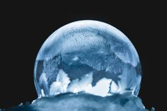 Christmas Snow Globe Snowflake. Frozen snow globe christmas magic ball with flying snowflakes. Winter Background. For Christmas and New Year Holidays precious Stock Photography