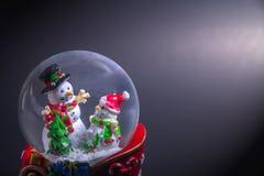 Christmas snow globe with snowman Royalty Free Stock Photos